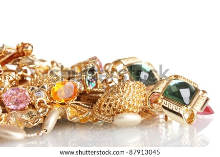 Various gold jewellery isolated on white - stock photo