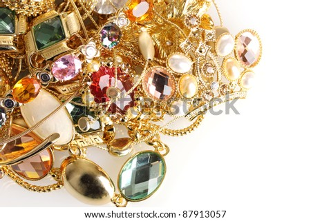 Various gold jewellery isolated on white