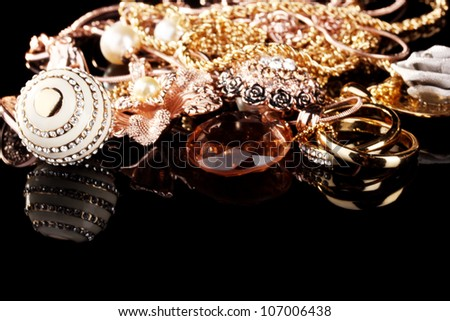 Various gold jewellery on black