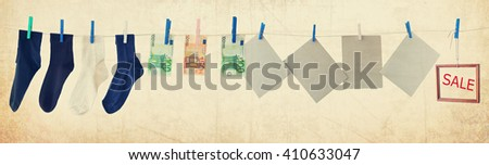 Various goods and things, hanging on a clothesline. Sale. Old paper texture background. Vintage style image