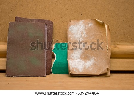 Various grades or grit of used sandpaper.