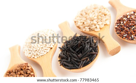 Various Grains in Wooden Spoons - stock photo