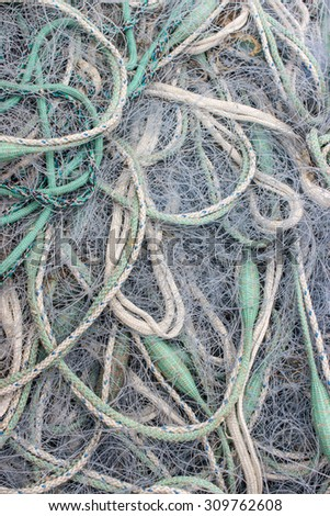 various green and white fishing nets / Fishnet / at the harbor - stock photo