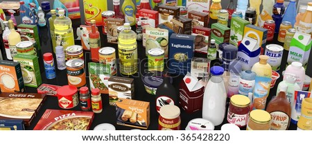 Various grocery products closeup, on black background with reflections - stock photo
