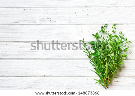 various herbs on kitchen table - stock photo