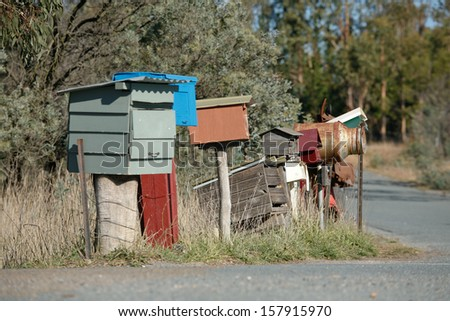 Various homemade and unusual Rural Letterboxes on the side of a country road - stock photo