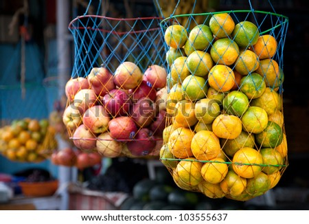 Various Indian oranges and apples in bags at the market, Kumly, Kerala, India