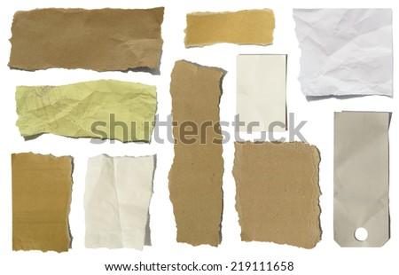 Various isolated torn and cut paper and cardboard scraps  - stock photo