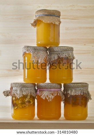 various jars of honey and nuts - stock photo