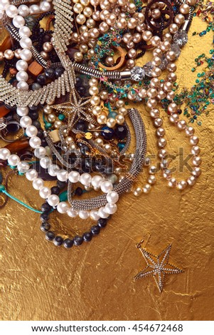 various jewelry on a gold background