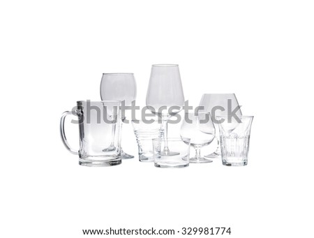 various jugs and empty glasses isolated on white endless background - stock photo