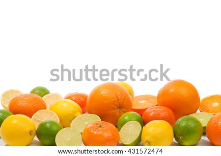 Various juicy ripe citrus fruits against white background; Whole and halved oranges, limes and lemons; Fresh and vitamin-rich ingredients for delicious juices and cocktails - stock photo