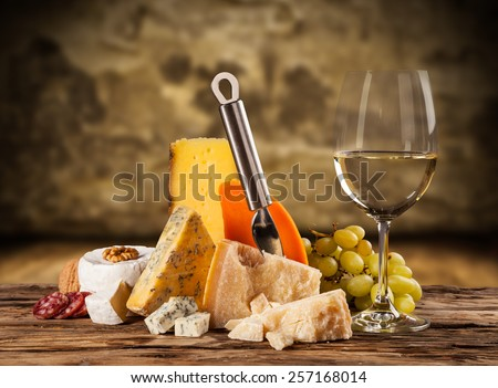 Various kind of cheese with white wine - stock photo