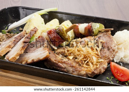 Various kind of grilled meat and sausages in european style - stock photo