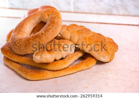 Various kinds of bread freshly baked - stock photo
