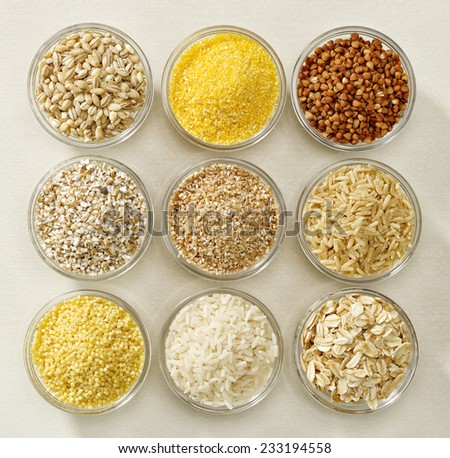 various kinds of cereal grains in glass bowls - stock photo