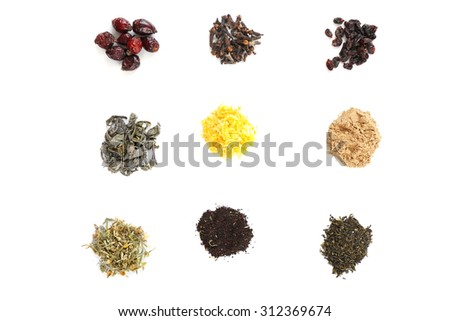 Various kinds of herbal tea and herbs isolated on white - stock photo