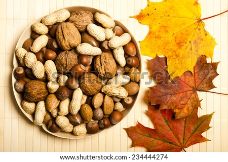 various kinds of nuts in wooden bowl - stock photo