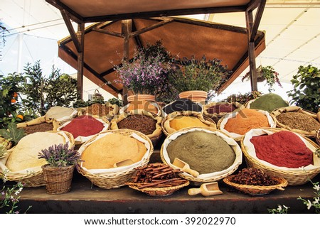 Various kinds of spices in the marketplace. International cuisine. - stock photo