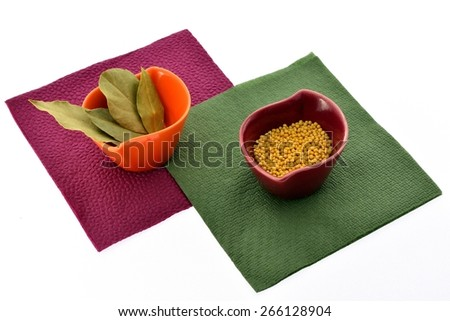 Various kinds of spices in tiny cups on napkins - stock photo