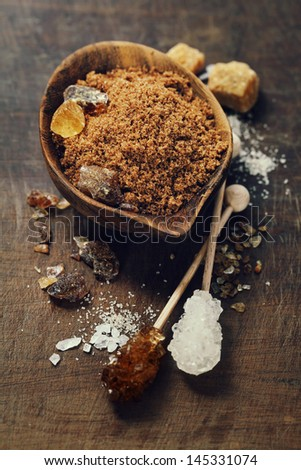 Various kinds of sugar in wooden bowls - stock photo