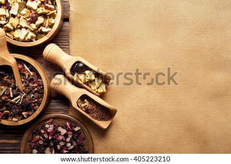 Various kinds of tea and blank handmade paper sheet - stock photo
