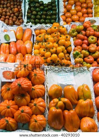 Various kinds of tomatoes on a marketplace