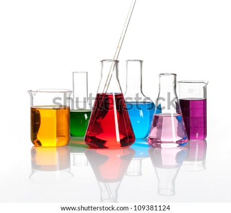 Various laboratory flasks with a colored reagents, isolated - stock photo