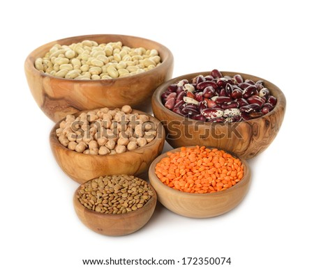 Various legumes in wooden bowl isolated on white background - stock photo