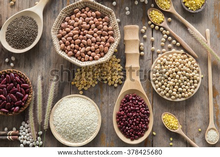 Various legumes on Scoop wooden  - stock photo