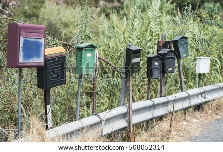 Various mailboxes. Different colors and shapes