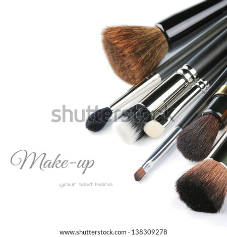 Various makeup brushes isolated over white - stock photo