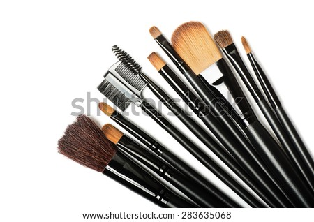 Various makeup brushes isolated over white background  - stock photo