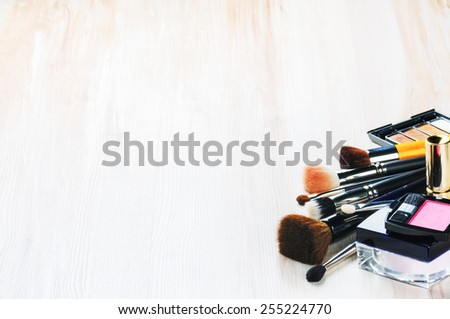 Various makeup products on light background with copyspace - stock photo