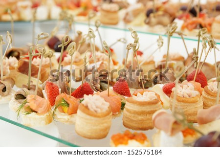 Various meat, fish and cheese banquet snacks - stock photo