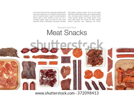various meat snacks on white background with copy space top view