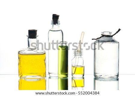 Various medicine or cosmetic bottles on the white background with reflection