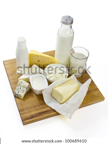 various milk products on the board with clipping path included - stock photo