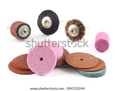 Various mini rotary tool bits. Shot against white background. - stock photo