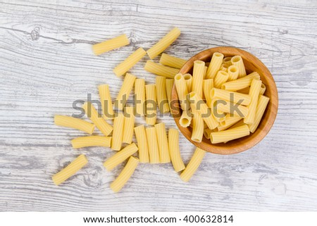 Various mix of pasta on wooden rustic background, sack. Diet and food concept. diversity
