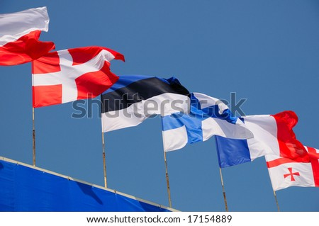 various national flags flapping in the wind