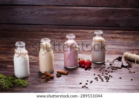 Various natural milkshakes on a wooden background.Ingredients for cocktails. - stock photo