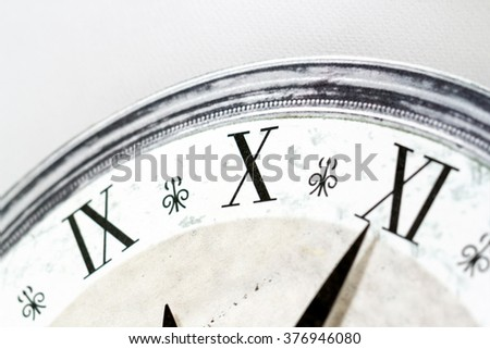 various numbers shown on vintage clock surface - stock photo