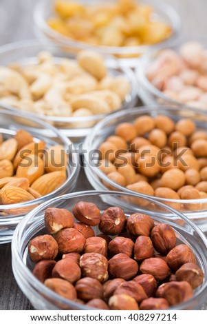 Various nuts in small glass bowls