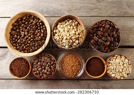 Various of coffee in small dishes on wooden table, top view - stock photo