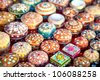 Various of different colorful jewel boxes in Indian market - stock photo