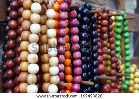 Various of different colorful necklace at flea market - stock photo