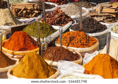 Various of Indian colored powder spices on the flea market in India, Goa. - stock photo