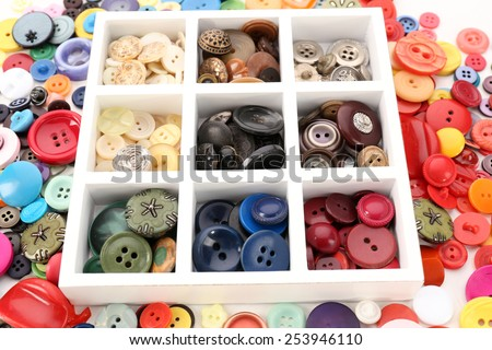 Various of sewing buttons in box on white background, macro view