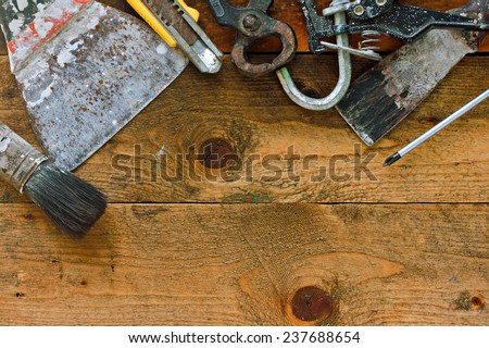 Various old diy tools on rustic work bench - stock photo